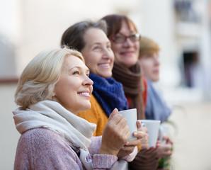 Senior women drinking tea at balcony