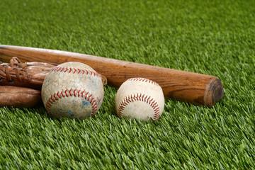 closeup soft ball and hardball