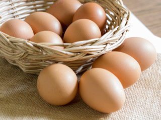 eggs in a basket on table