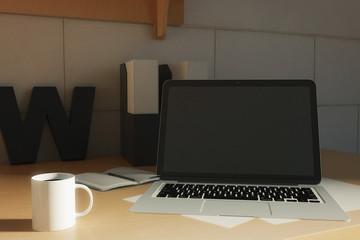 Blank laptop on creative desktop
