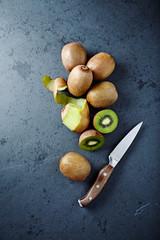An Arrangement of Kiwi Fruits on a Black Slate