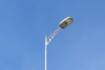 Modern street lighting against blue sky. Bottom view. Horizontal image Fotomurales