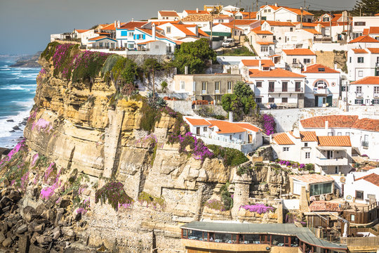 Azenhas do Mar white village landmark on the cliff and Atlantic