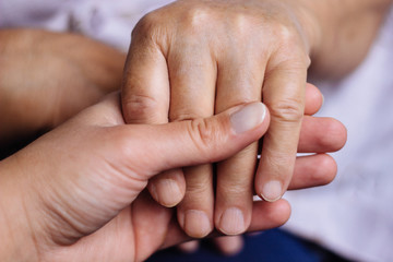 Two people holding each other's hands
