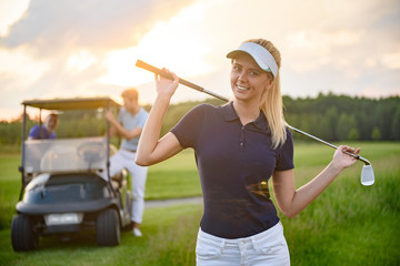Young girl holding her golf club