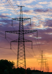 metal Bearing high voltage power line during sunset or sunrise