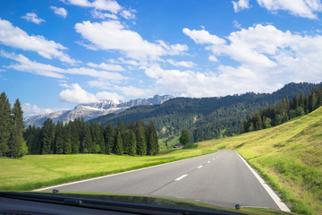 Driving through the scenic Emmental valley in Switzerland. View from the front seat while moving.