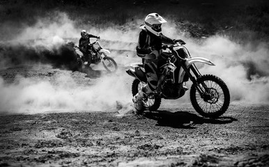 Motocross racer accelerating in dust track, Black and white photo Wall mural