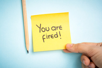 You are fired from job. Yellow paper note.
