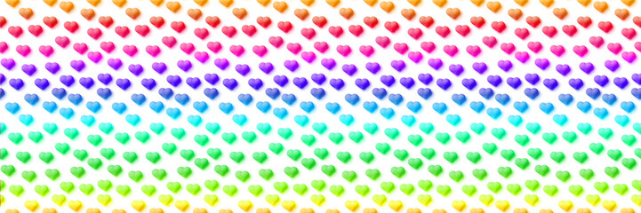 seamless banner of small hearts in horizontal stripes of vibrant rainbow colours on a white background (format 3x1, 3d illustration)