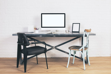 Chairs at designer desk