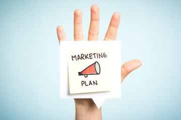 Marketing plan. Sticky note, illustration, megaphone and blue background