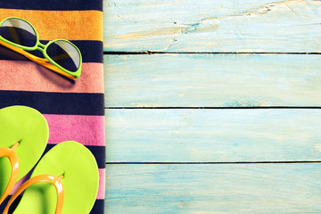 Summer beach accesories on wooden boards