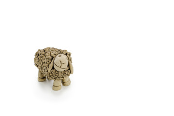 Clay sheep on white table