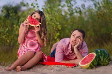 happy pregnant couple in picnic