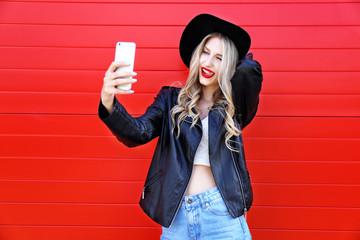 Fashion hipster woman taking selfie.