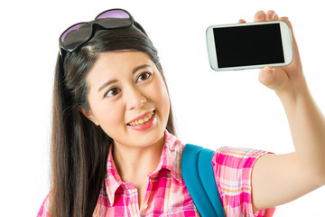 Happy asian woman tourist taking selfie