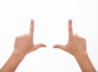 Man showing a rectangle shape