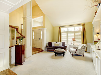 Luxury home well decorated golden living room with beige carpet.