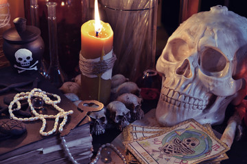 Close up of skull, candlebook and the tarot cards