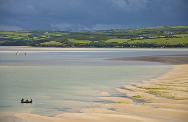 Small boats in the River Camel estuary near the Town bar sand bar, Padstow, North Cornwall, England, United Kingdom