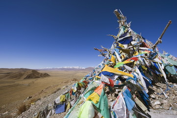 Prayer flags and sacred site overlooking Bayanbulak, Xinjiang Province, China, Asia