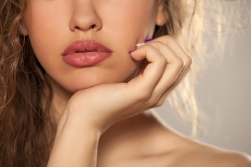female lips, hand, nose and shoulder