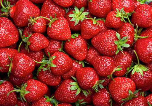 Strawberry background.  Red ripe organic strawberries on market
