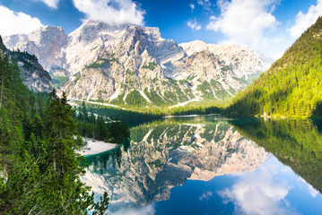 In de dag Reflectie Lake Braies also known as Lago di Braies. The lake is surrounded by the mountains which are reflected in the water.1st point of the trekking route Alta Via 1, The Dolomites, Alps, South Tyrol, Italy.