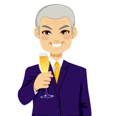 Successful smiling senior businessman toasting with a glass flute full of champagne