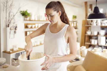 Woman working in ceramics workshop