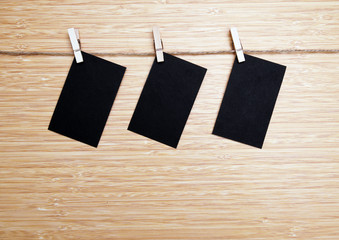 black cards hanged on a nylon thread.