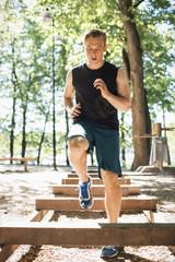 Full length of man exercising at outdoor gum