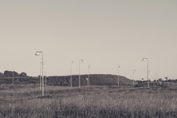 Many streetlamps on a meadow