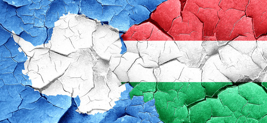 antarctica flag with Hungary flag on a grunge cracked wall