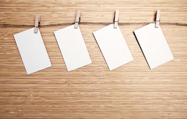 four pieces of white card.  rustic mood image filter applied in post processing.