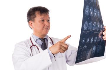 Matured Asian neurology medical doctor examining head MRI images