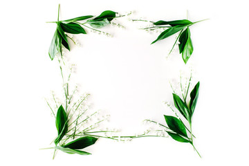 wreath frame with lily of the valley, branches and leaves isolated on white background. flat lay, overhead view