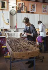 Woman working in furniture workshop