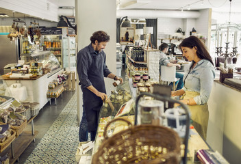 People working in delicatessen