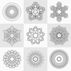 Set of decorative design elements isolated on grey background.  Flowers, snowflakes, abstract floral pattern, star, sun. Vector logo,  sign, stick figures. Floral ornament. Coloring Design template