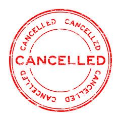 Grunge round red cancelled stamp on white background