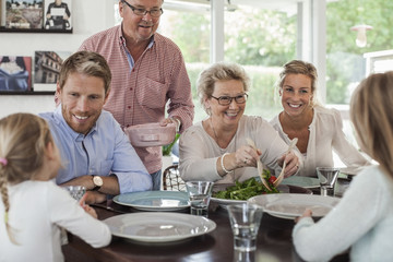 Multi-generation family having lunch together at home