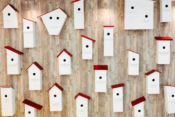 Birdhouses on the wall. Neighborhood and property concept