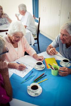 Group of seniors drawing and interacting