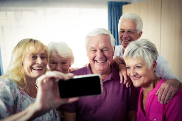 Group of seniors doing a selfie with a smartphone