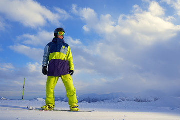 snowboarder standing on the board in the mountains
