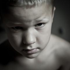 Portrait of little boy staring