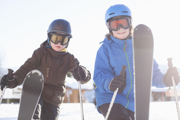 Siblings skiing together