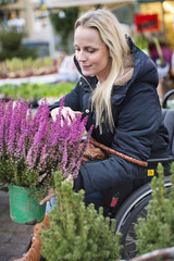 Woman with potted heather
